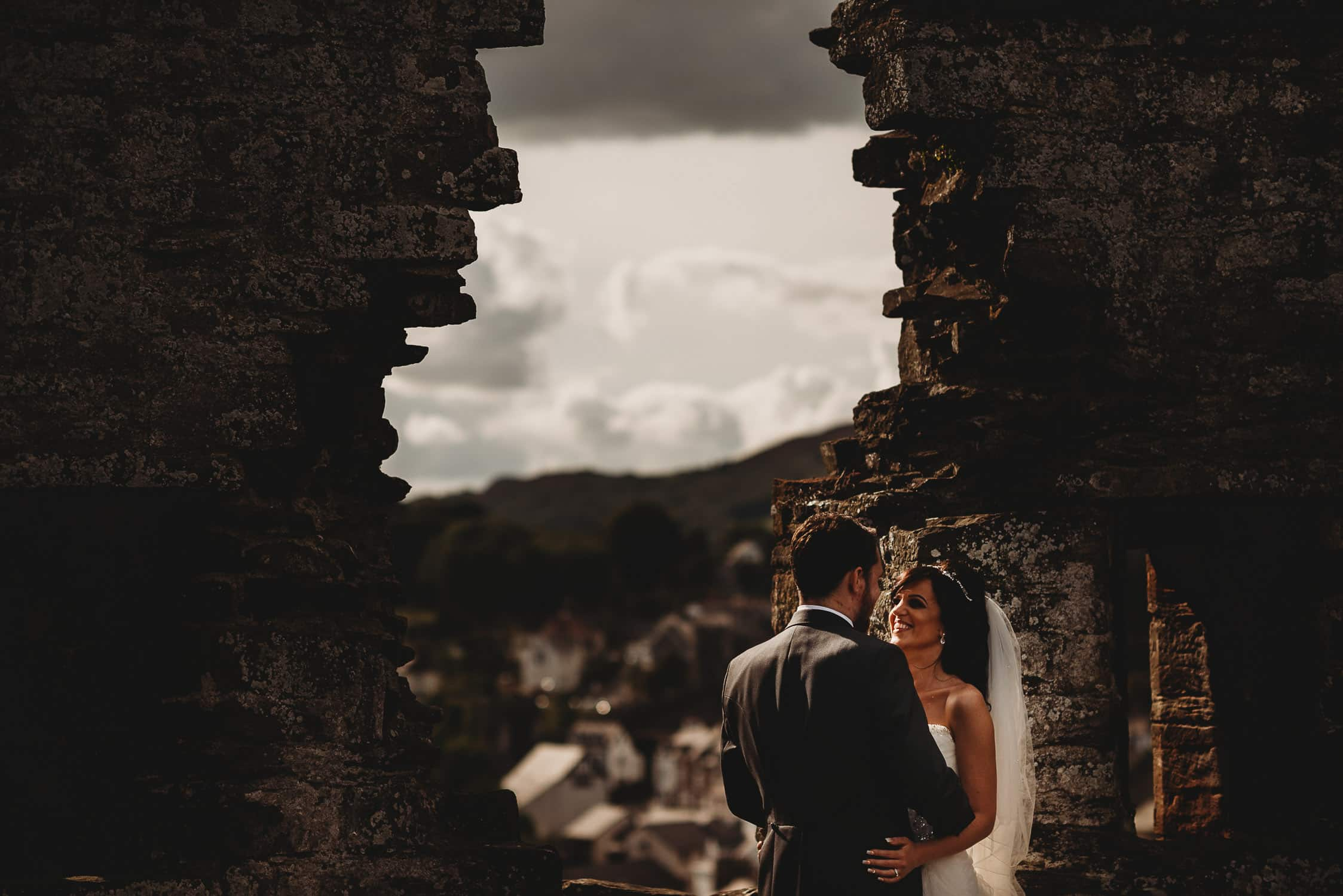 bride and groom at Conwy Castle
