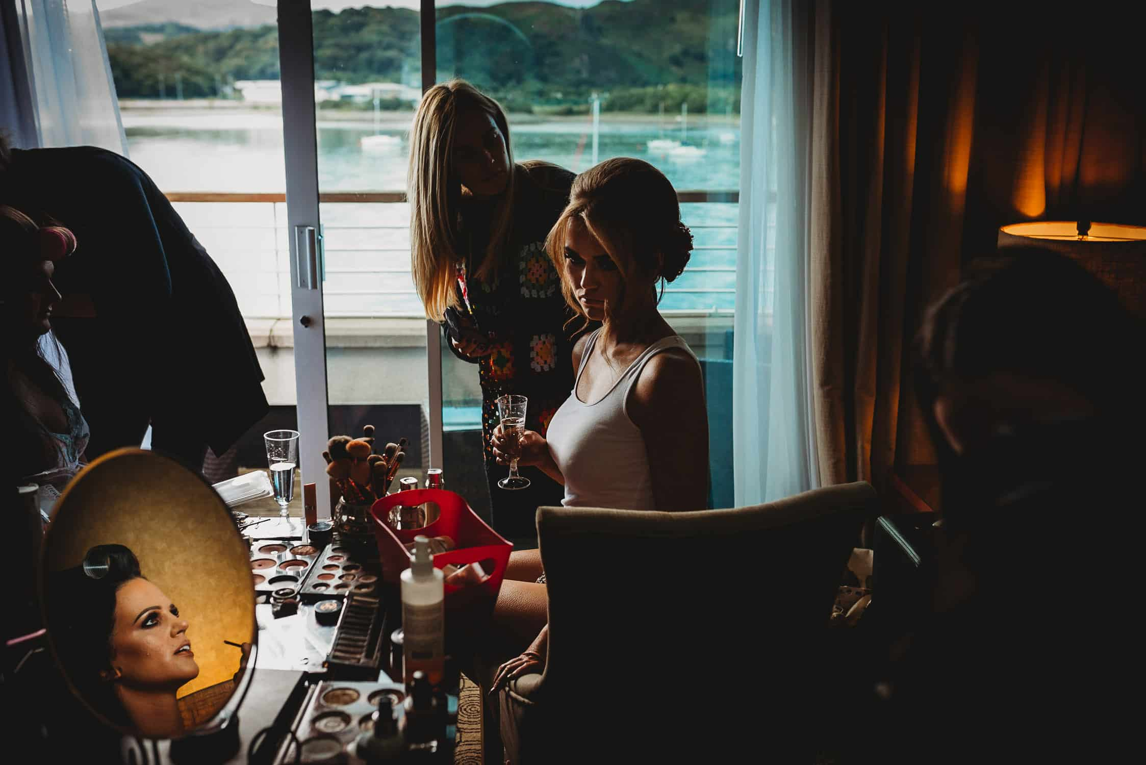 The Quay Hotel Wedding Photographer in Conwy North Wales bridesmaid and bride during bridal prep