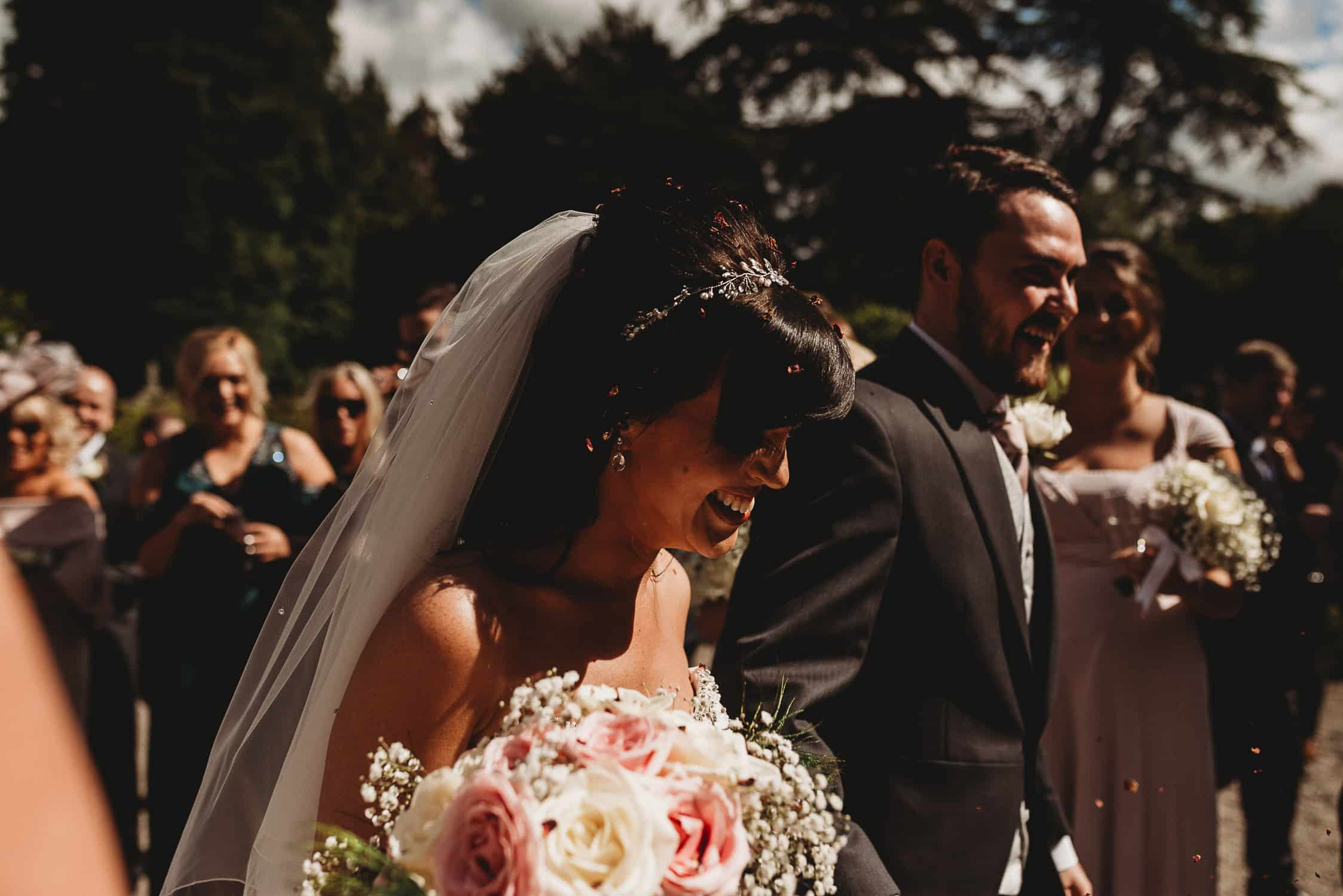 portrait of groom & bride from the side at Gwydir Castle