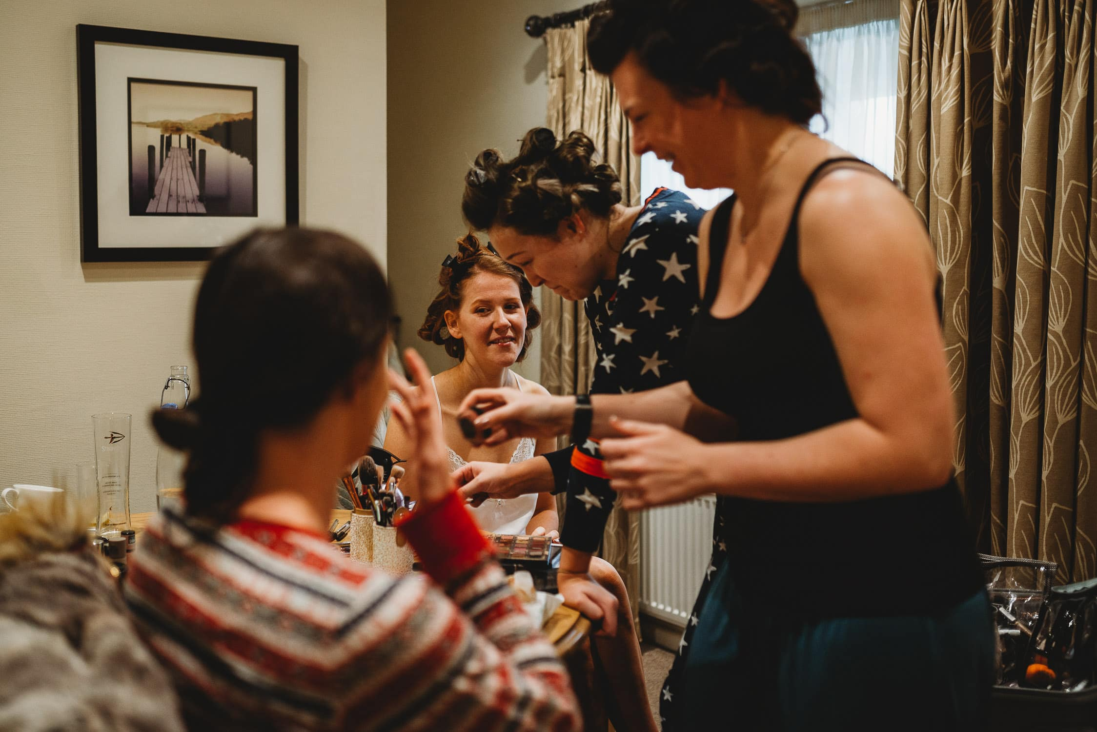 bridesmaids and bride during bridal prep at Stirk House
