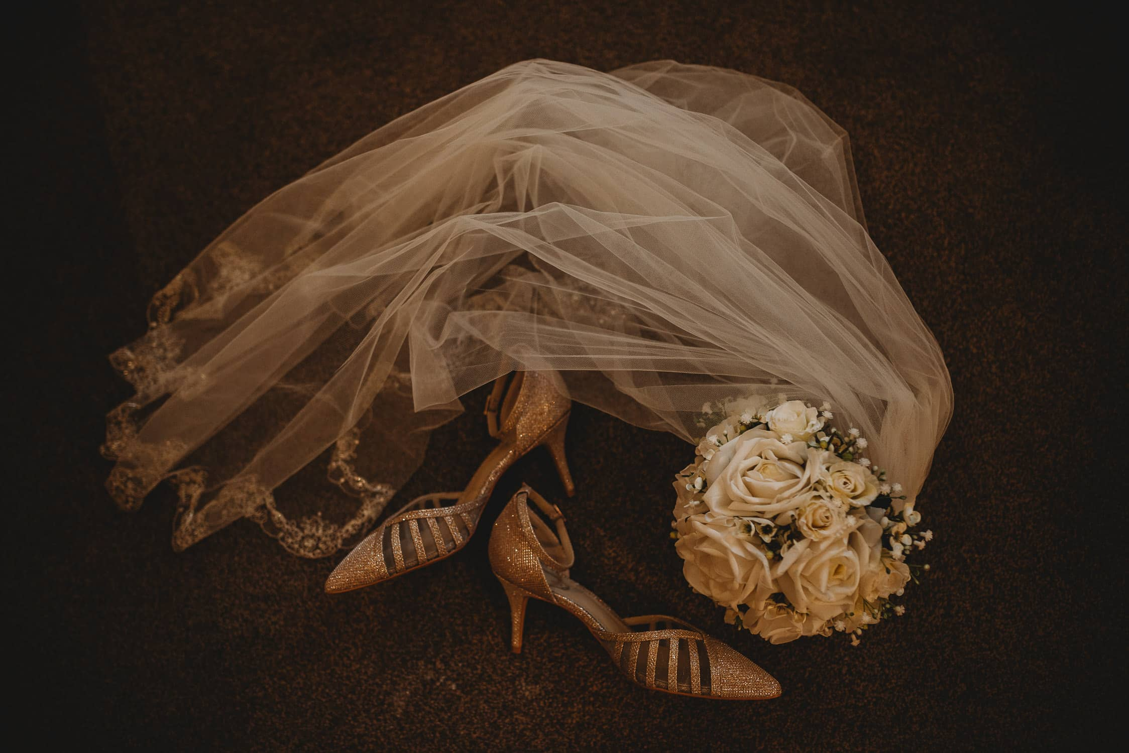 bride's veil, flowers and shoes