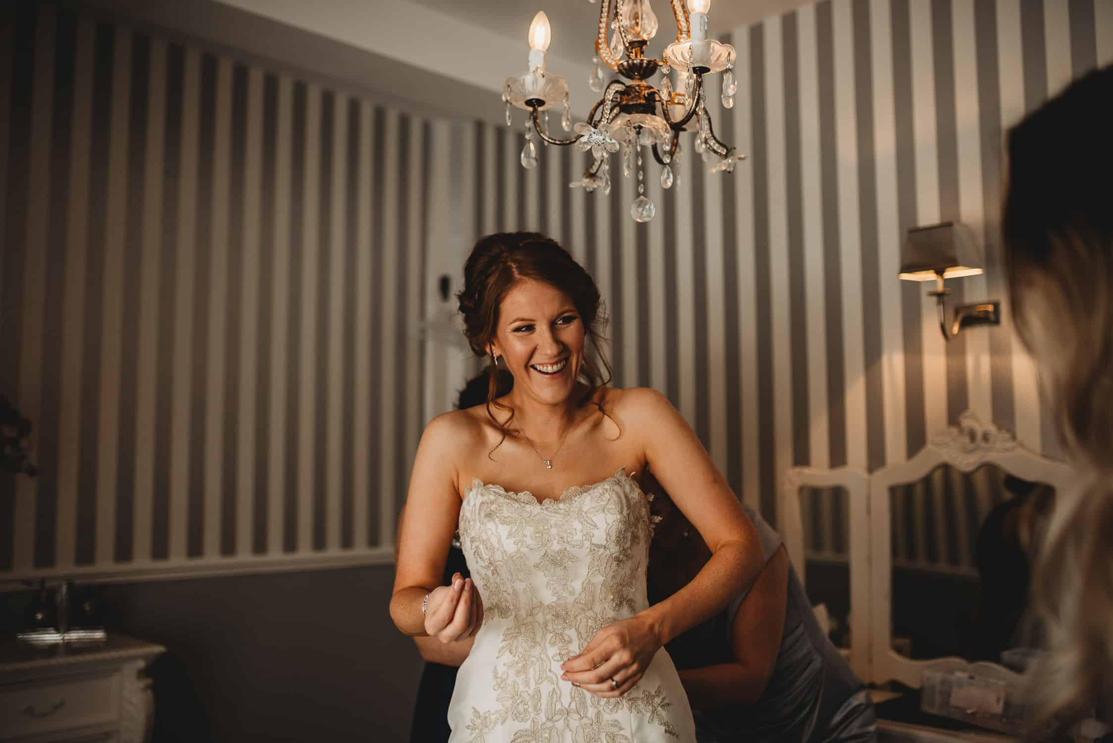 bride smiling during bridal prep