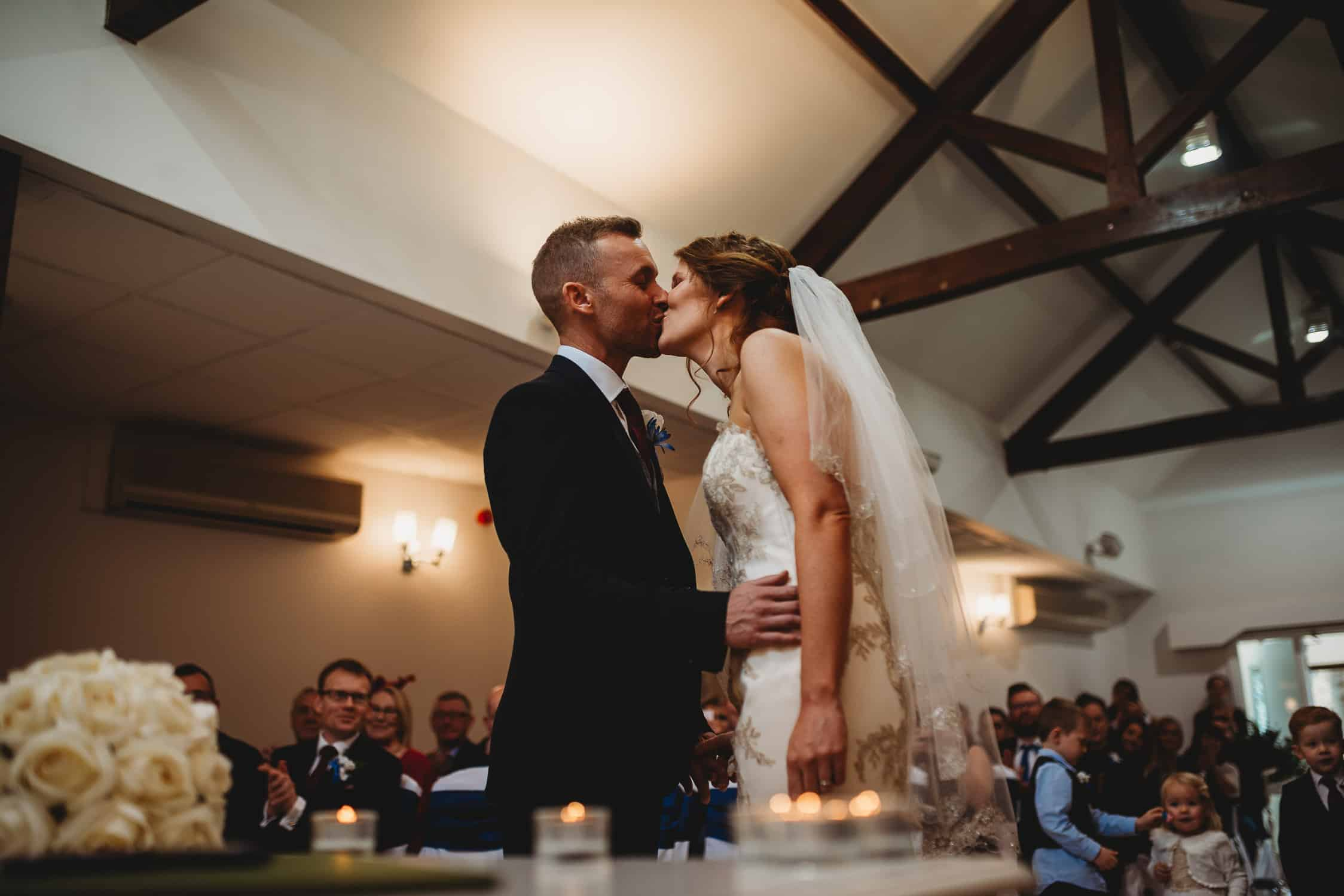 bride and groom kissing after wedding ceremony at Stirk House in Lancashire