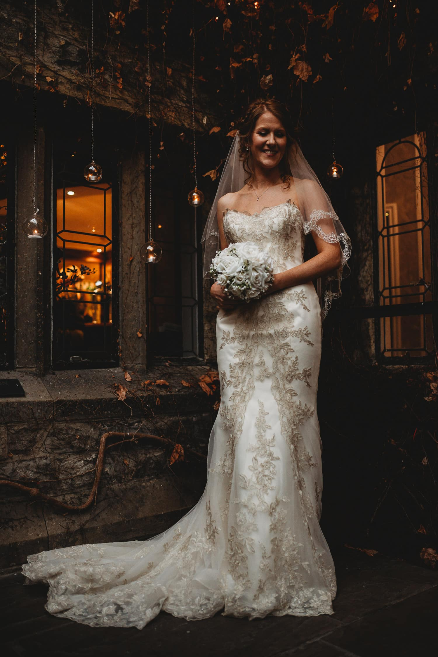 portrait of bride holding her bouquet at Stirk House in Lancashire