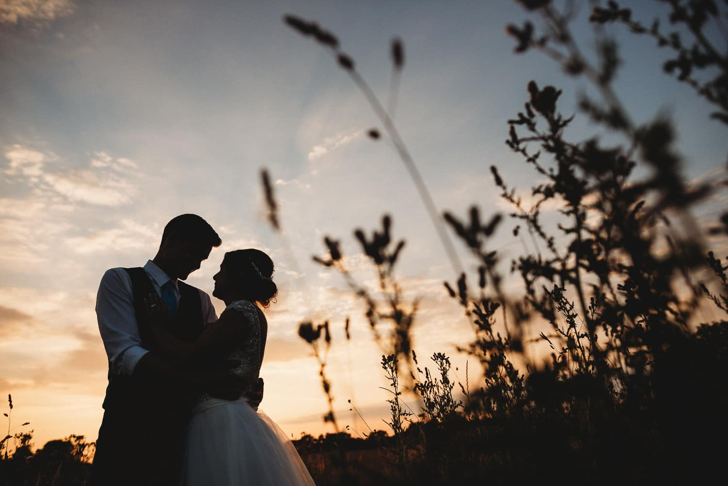 bride and groom at sunset at Langley Abbey in Norfolk by Best North Wales Wedding Photographer
