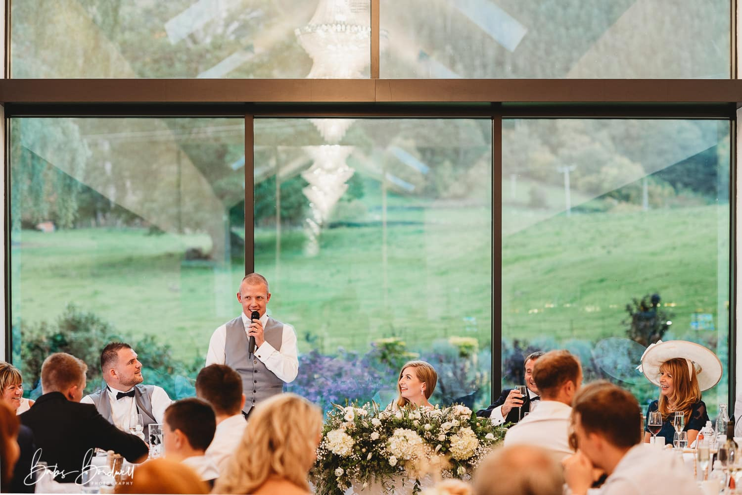 groom giving his speech at the garden room at Tyn Dwr Hall