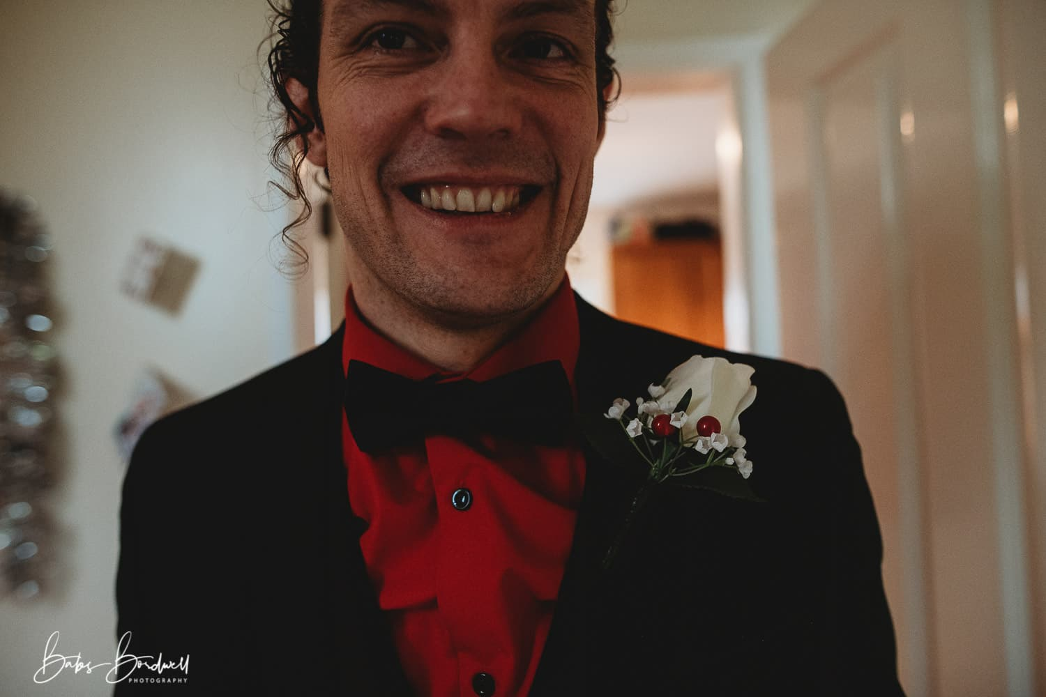 picture of groom smiling