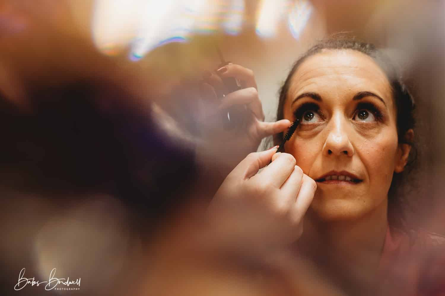 bride having her make-up done North Wales Wedding Photographer at Holt Lodge