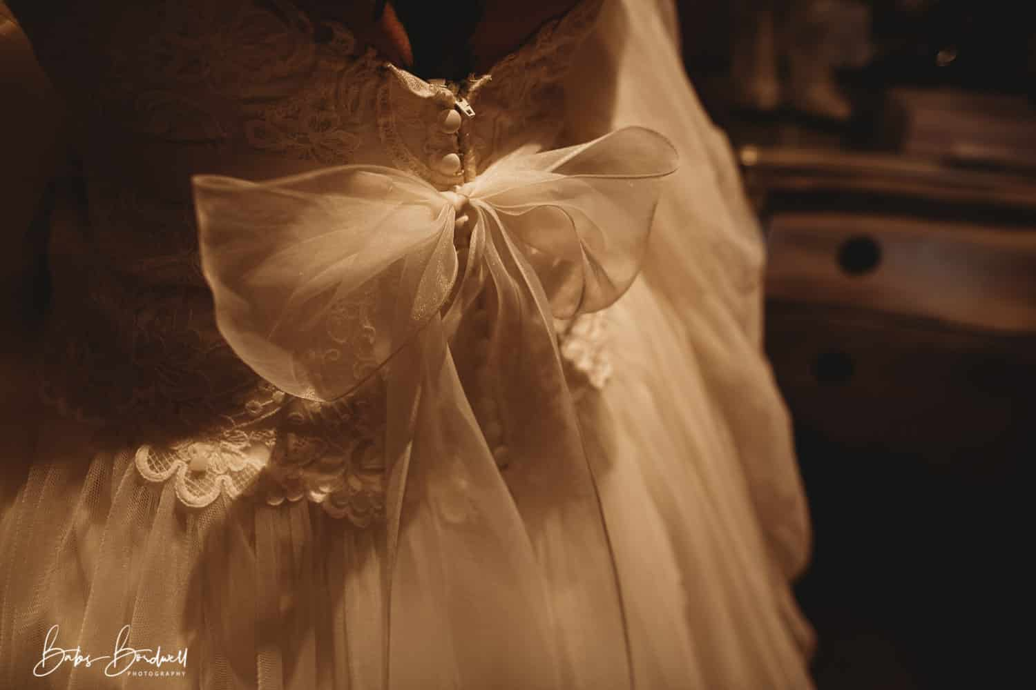 close-up of bow on bride's wedding dress