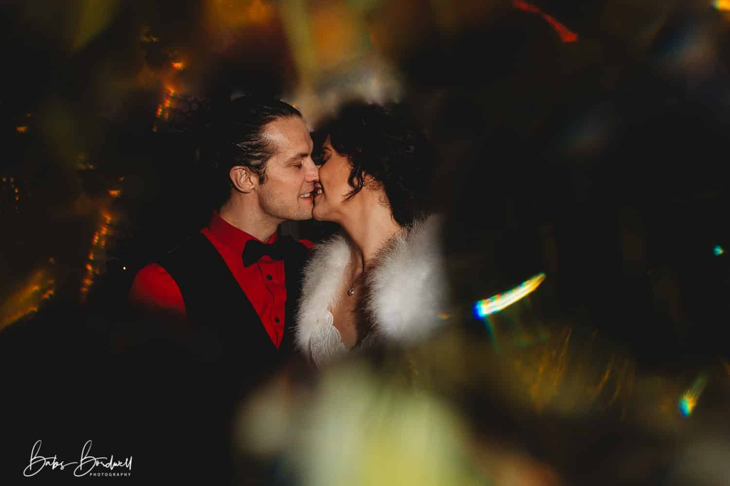 portrait of bride and groom kissing