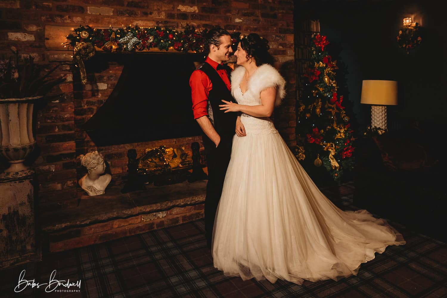 portrait of bride and groom next to christmas tree at Holt Lodge North Wales