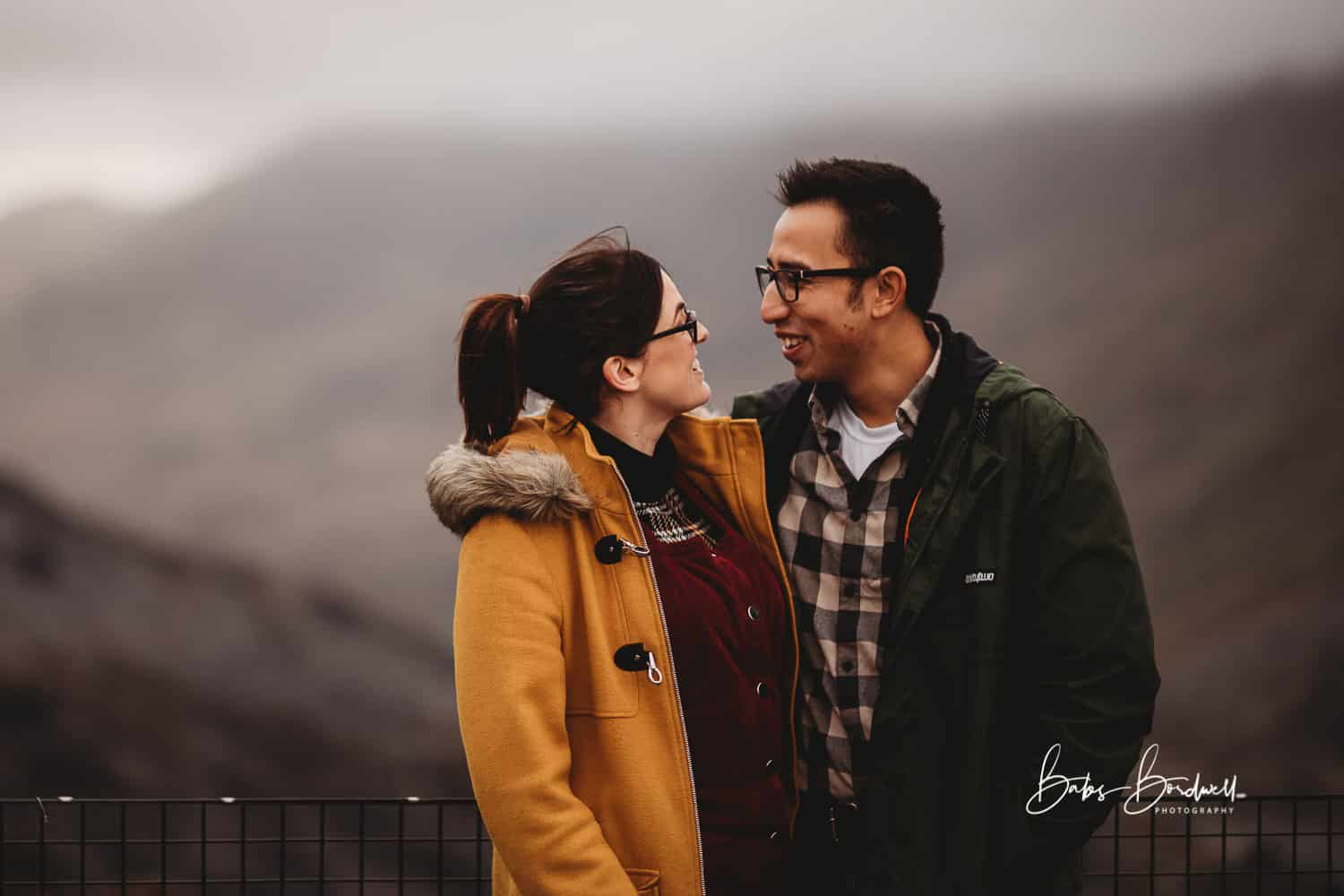 portrait of couple looking at each other smiling