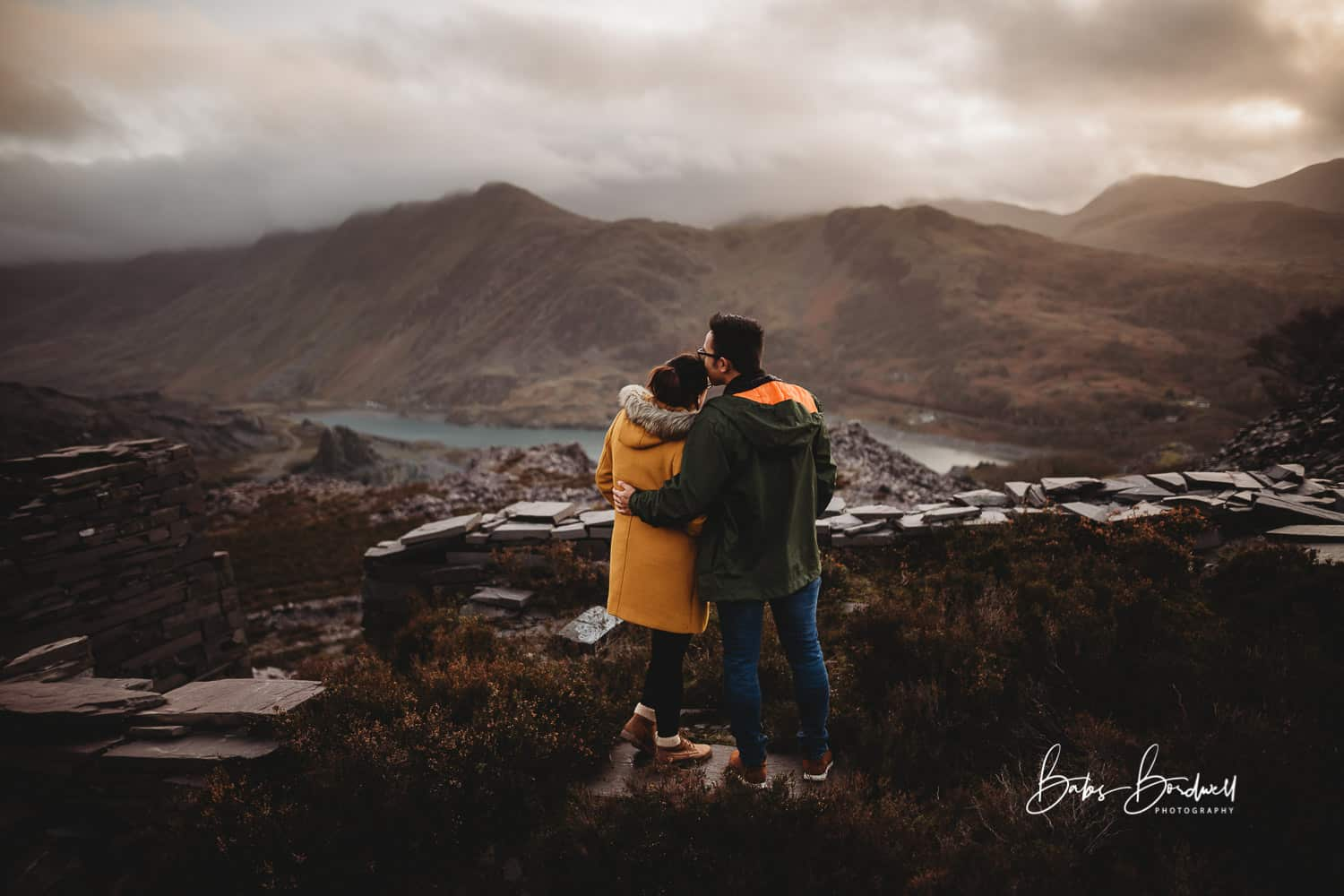 couple overlooking mountainous Snowdonia backdrop