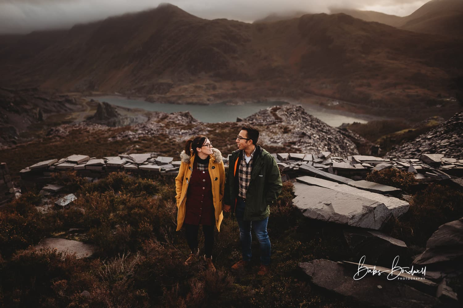 North Wales Wedding Photographer - bride and groom to be during pre-wedding shoot at Llanberis against mountain backdrop