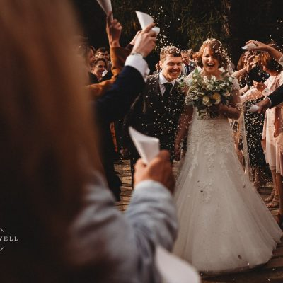 couple during their confetti shot at Quarry Bank Mill