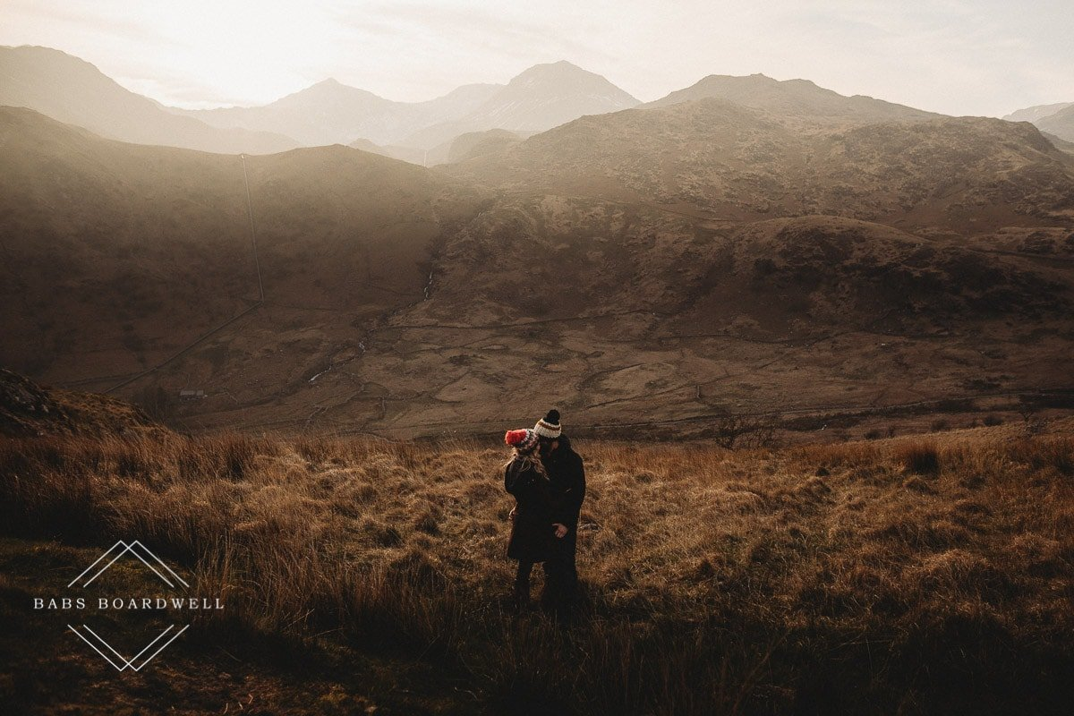 couple hugging each other during scenic pre-wedding shoot at the base of Snowdon