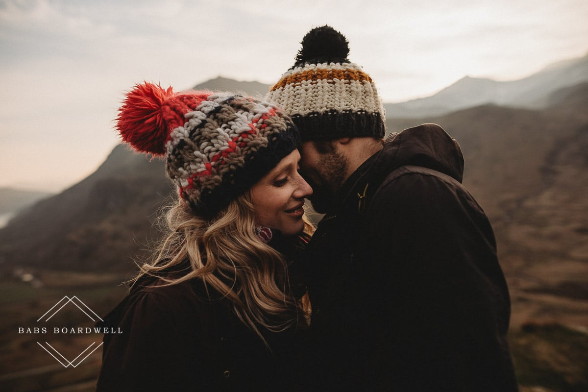 close-up of couple hugging wearing knitted bobble hats