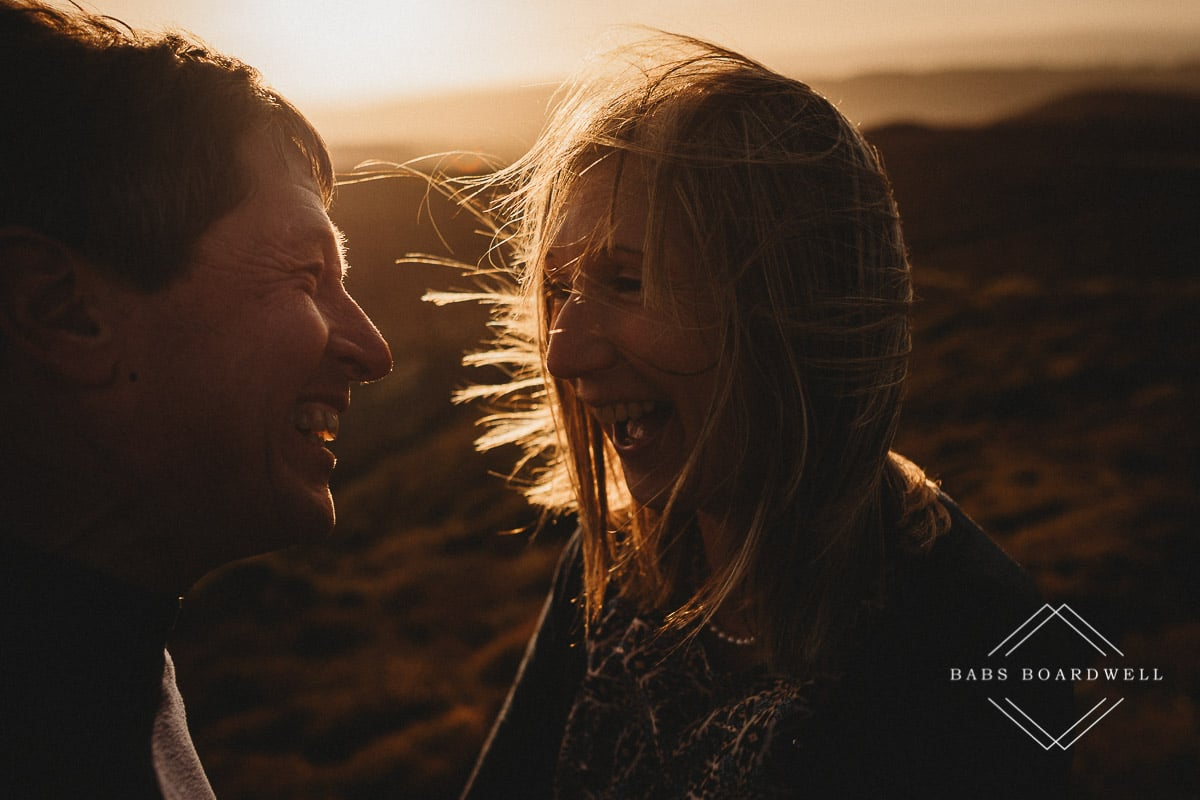 close-up of couple at sunset smiling at each other