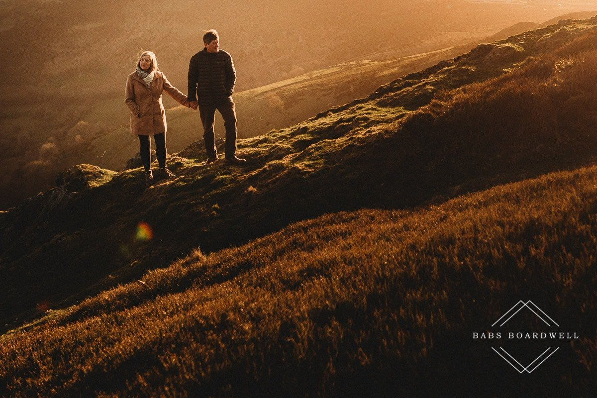 couple holding hands at sunset by Denbigh Wedding Photographer