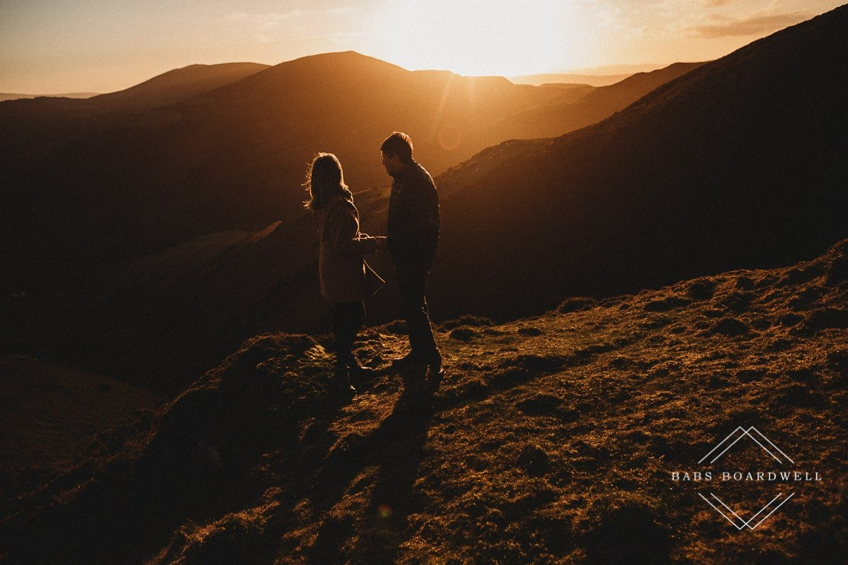couple holding hands at sunset in North Wales