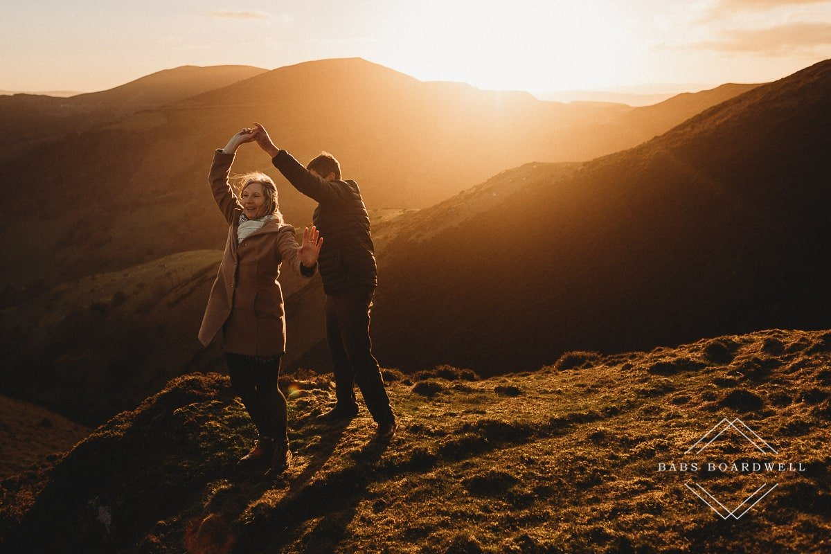 couple twirling at sunset in the Welsh hills by Denbigh Wedding Photographer