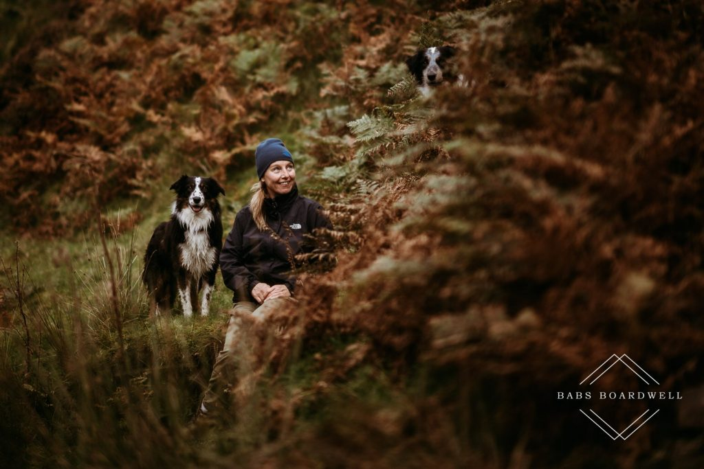 Babs Boardwell North Wales Wedding & Elopement Photographer with two of her dogs in an autumnal setting