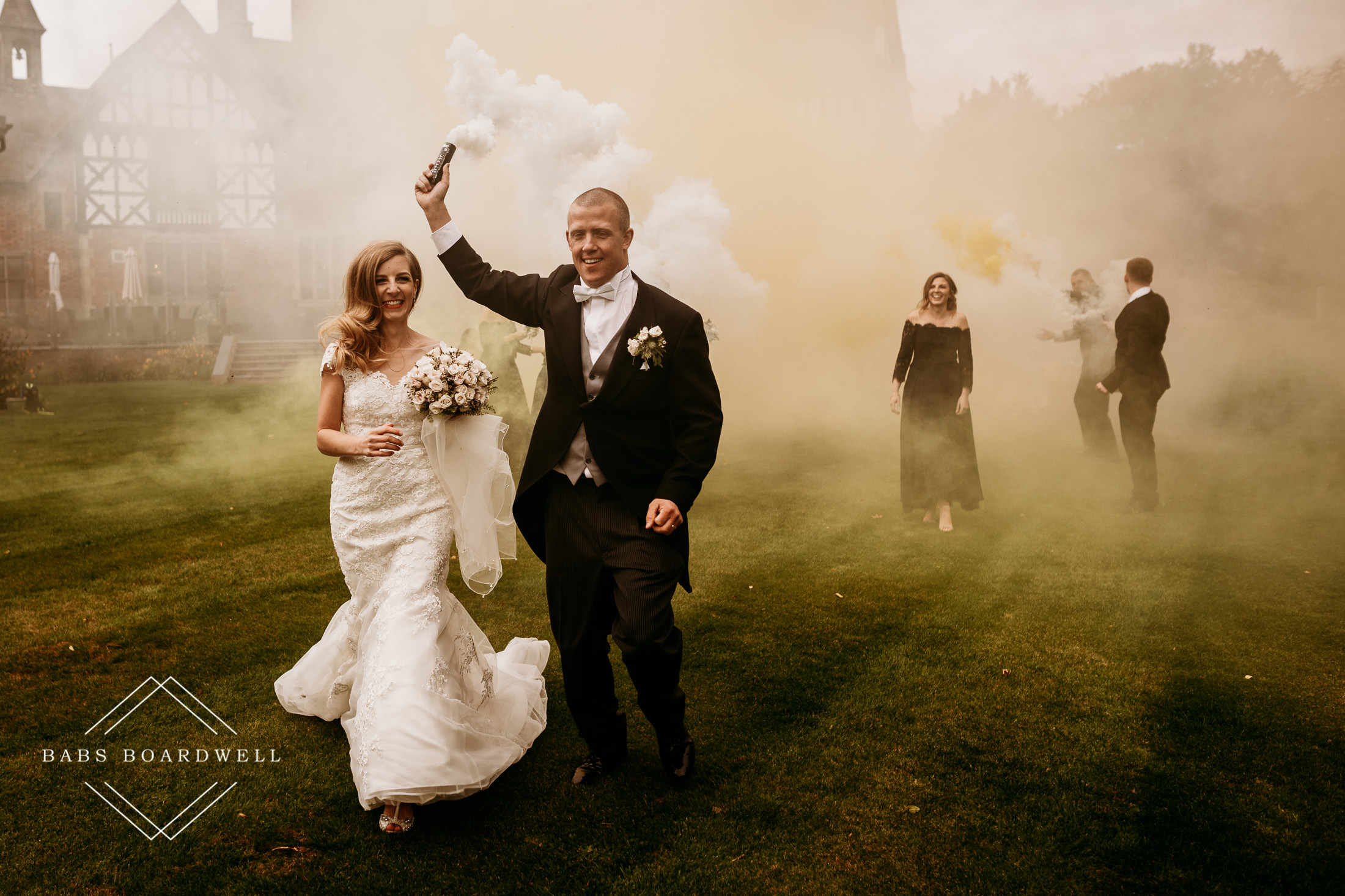 bride and groom with white smoke grenade during a romantic wedding at Tyn Dwr Hall