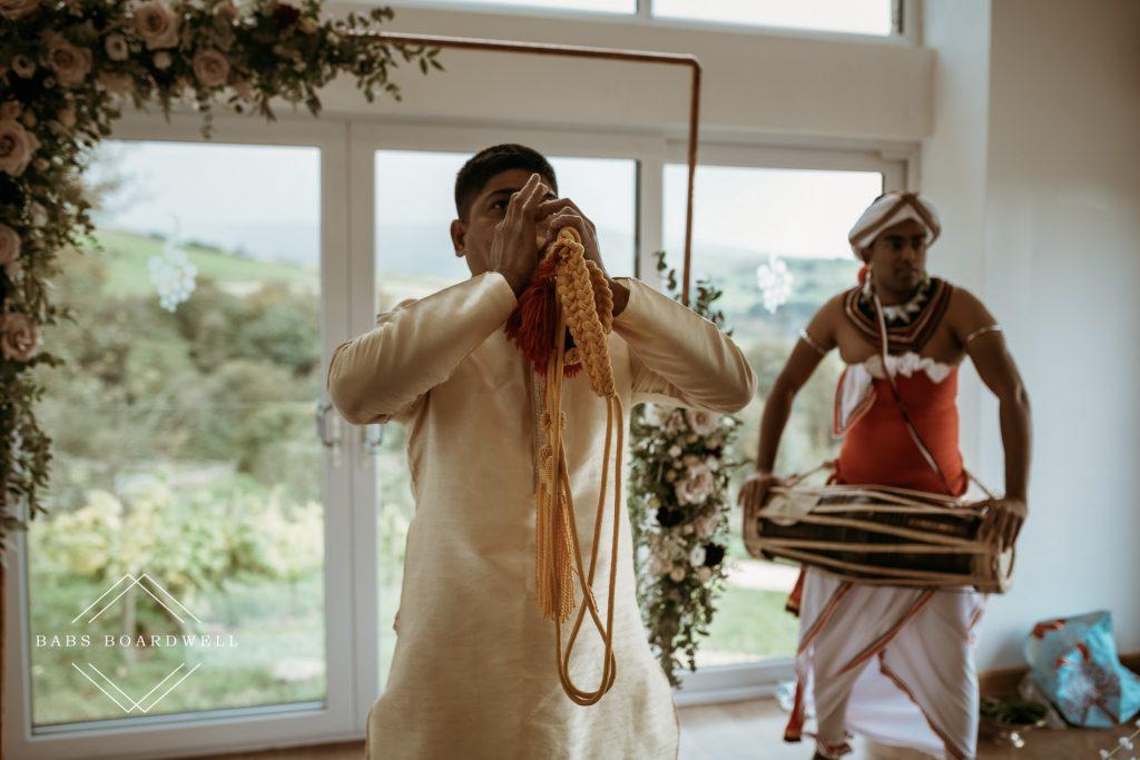 Sri Lankan holy man blowing an instrument at Holmfirth Vineyard