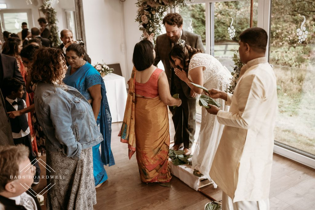 guests dressed in Sri Lankan dresses congratulating the bride and groom