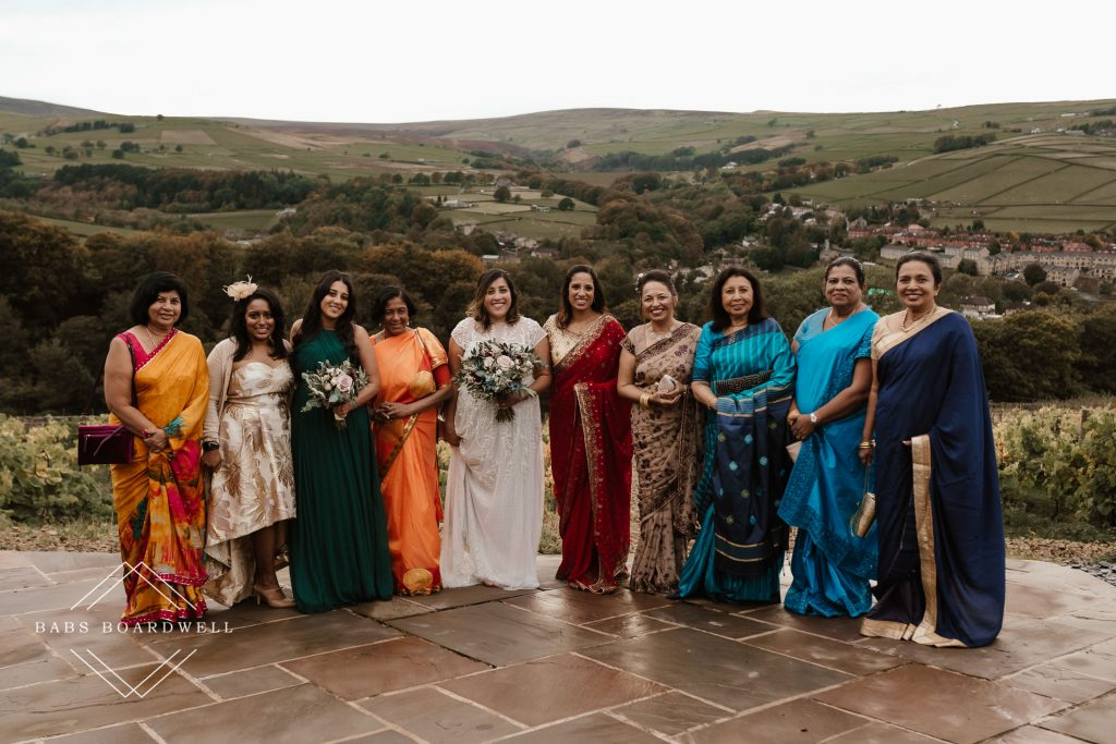 group shot of females wearing Sri Lankan dresses with the bride