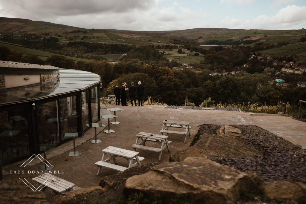 wedding guests looking at view from Holmfirth Vineyard
