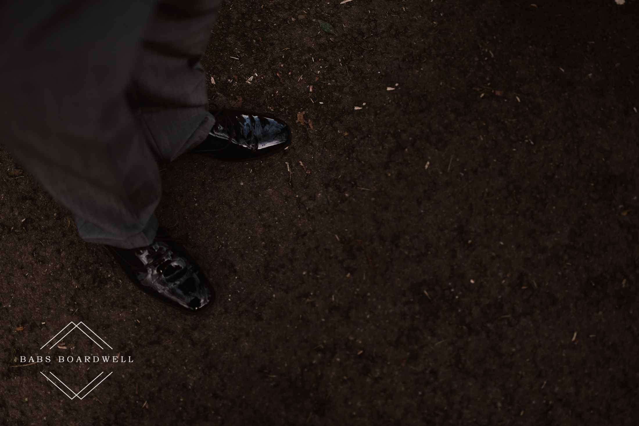close up of groom's shoes