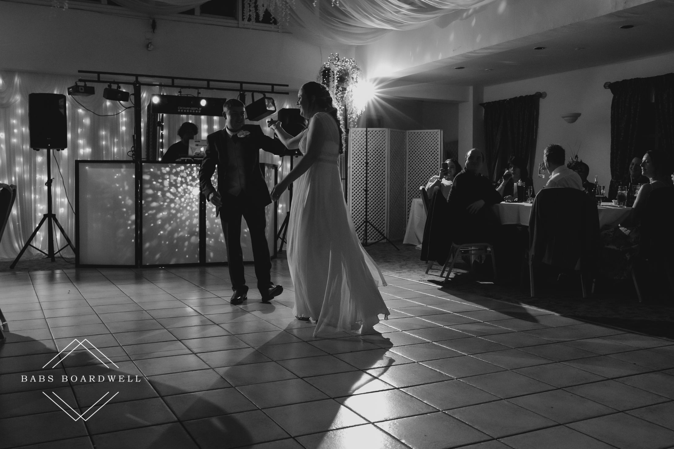 black and white image of bride and groom during their first dance at their spring wedding at Plas Hafod