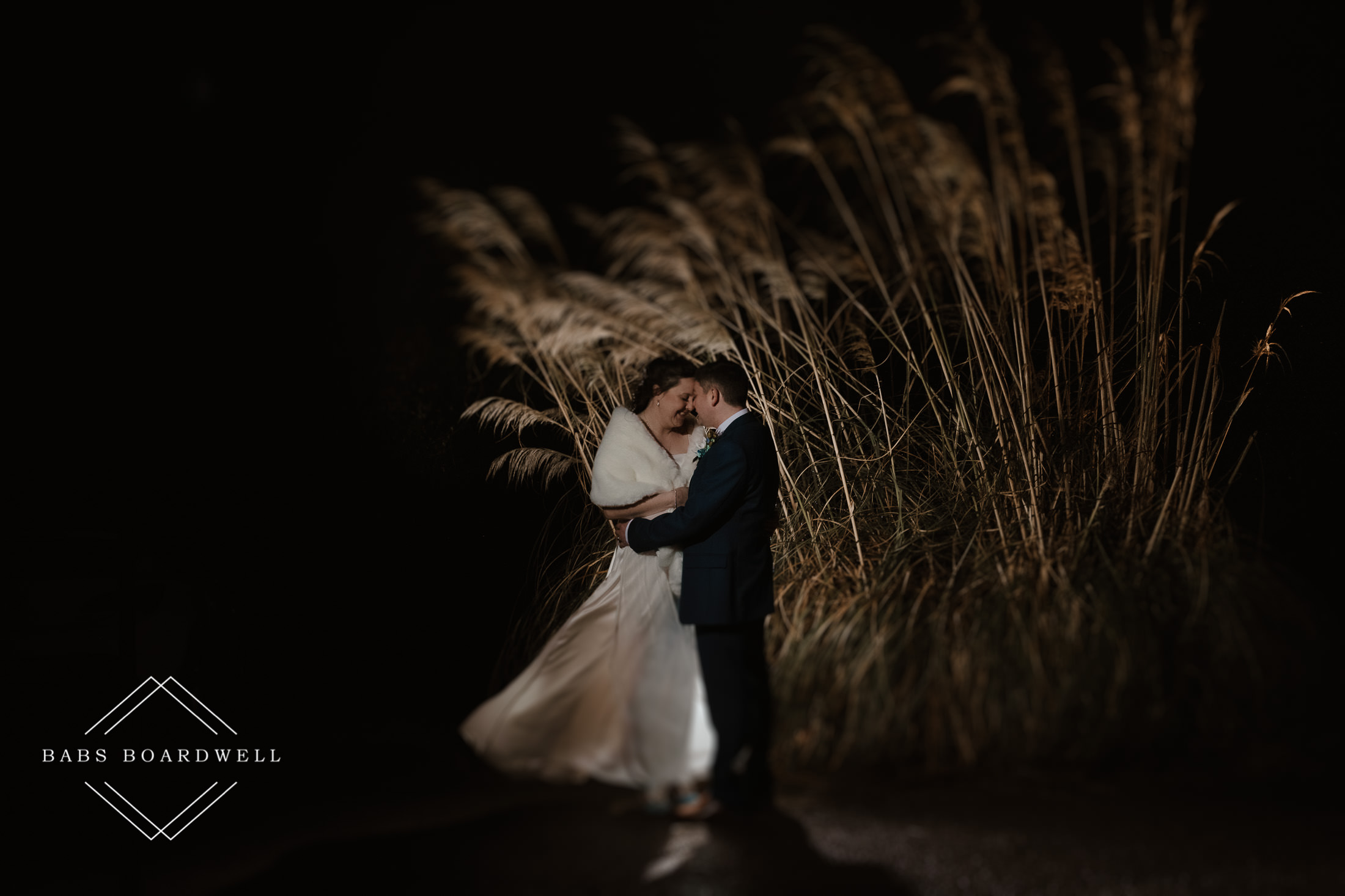 wedding day portrait of bride and groom at night outside Plas Hafod Country House Hotel