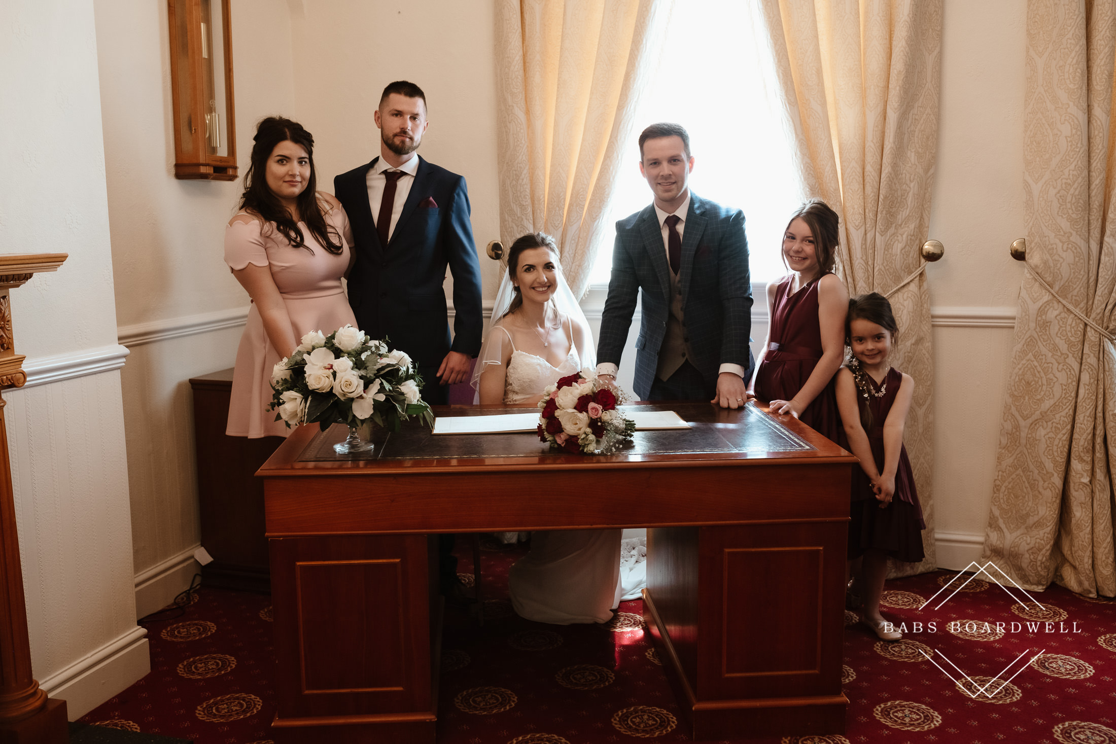 bride and groom with their bridesmaid, best man and flower girls at Llandudno Registry Office by North Wales Wedding Photographer