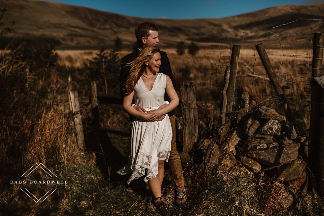 bride and groom looking in one direction with mountains in the background by Snowdonia Wedding Photographer