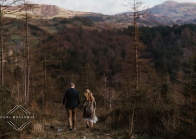 bride and groom walking hand in hand with Cadair Idris in the background by Snowdonia Wedding Photographer