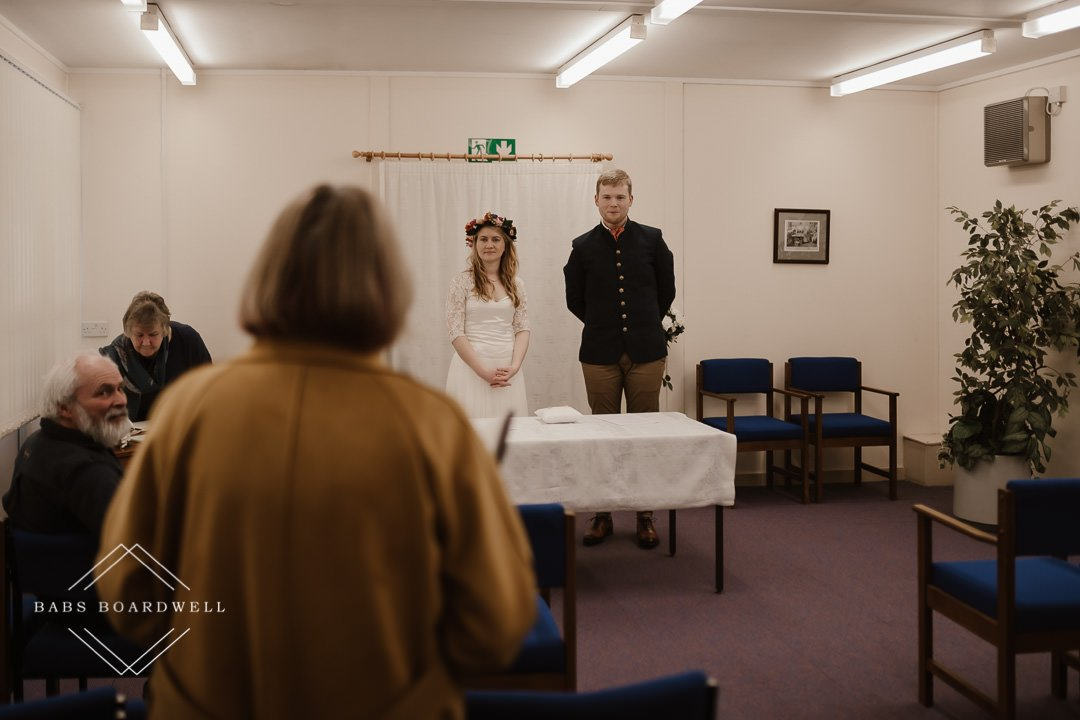 bride and groom inside the ceremony room at Dolgellau Register Office by Snowdonia Wedding Photographer