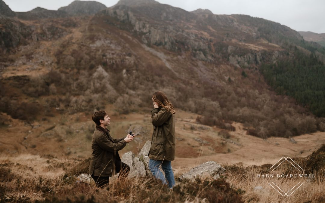 Romantic surprise proposal in the mountains